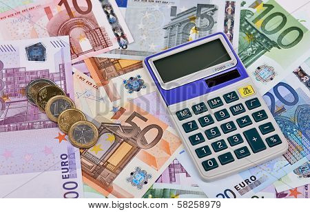 Euro Notes, Coins And Calculator