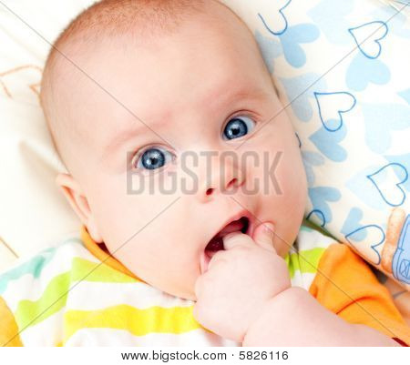 Infant With Hand In Mouth