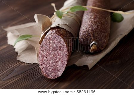 Salami On Wooden And Paper