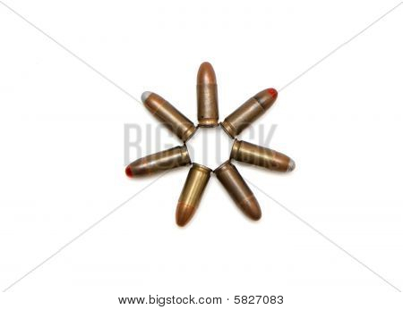 Seven-pointed star of 9mm Parabellum cartridges isolated