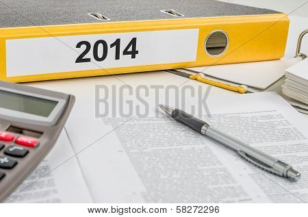A yellow folder with the label 2014