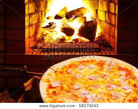 Pizza With Prosciutto Cotto And Open Fire In Oven