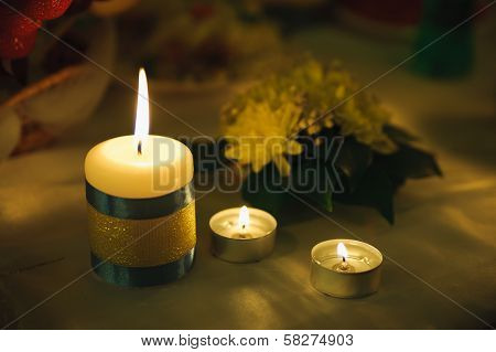 Three Small Candle Of Light. Holiday Romantic Ambience And Decoration