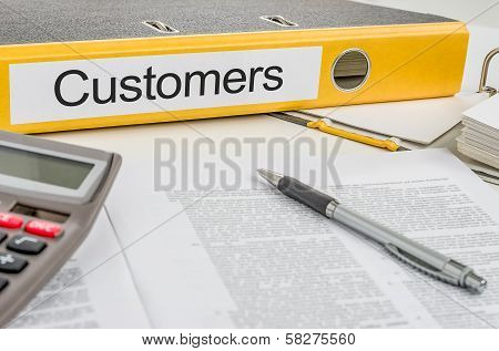 A yellow folder with the label Customers