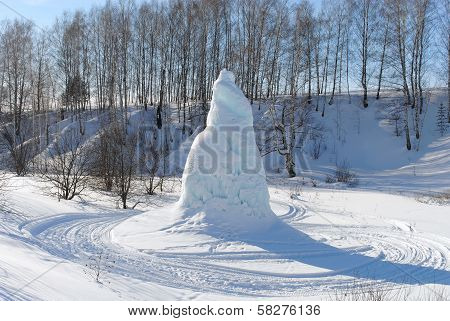 The ice fountain in a valley, against the blue sky