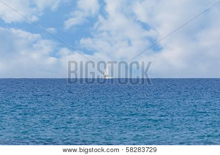 Peaceful Ocean Landscape With A White Yacht Afar Off