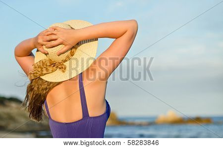 Woman In Straw Hat Sunbathing Near The Sea. Place For Text.