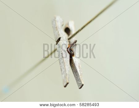 Old Wooden Clothespeg Hanging On Rope. Blur Background