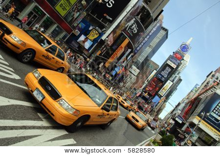 New York - August 28: Yellow Taxi Cabs Rush Tourists Around Times Square On August 28, 2009 In New Y
