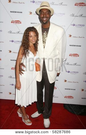 John Salley and wife Natasha at the DESIGNCARE 2007 Fundraiser to benefit those battling debilitating disease and life circumstances. Private Residence, Malibu, CA. 07-21-07