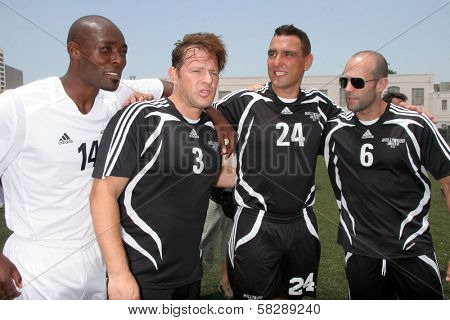Jimmy Jean-Louis and Costas Mandylor with Vinnie Jones and Jason Statham at the Soccer for Survivors Celebrity Showcase Match. Beverly Hills High School, Beverly Hills, CA. 07-22-07