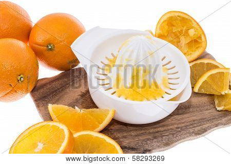 Squeezer With Fresh Oranges On White