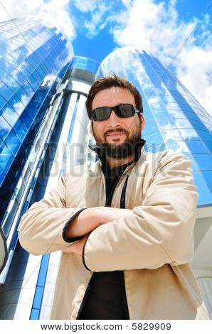 Young Attractive Man In Front Of Modern Building