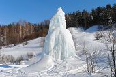 pic of natural phenomena  - The natural fountain which froze in the winter and turned into a huge ice monument - JPG