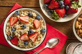 picture of cereal bowl  - Healthy Homemade Oatmeal with Berries for Breakfast - JPG