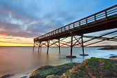 stock photo of mile  - Five Mile Point Pier Sunset view of the fishing pier at Lighthouse Point Park - JPG