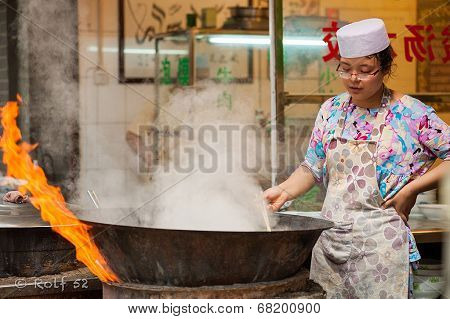 Fiery cooking at Muslim street, Xian
