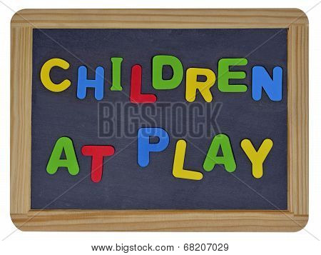 Children at play written on traditional school slate