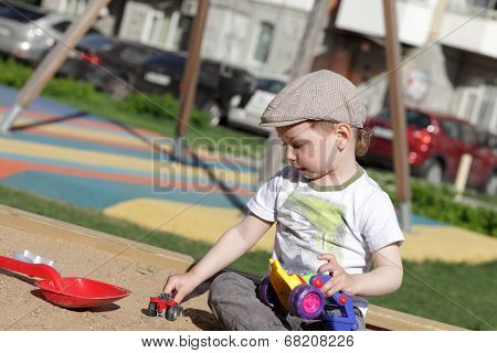 Child Playing In Sandbox