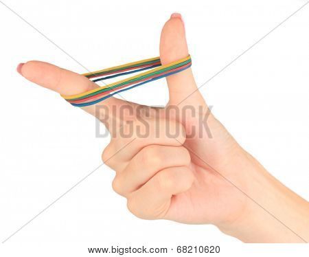 Colorful rubber bands in hand isolated on white