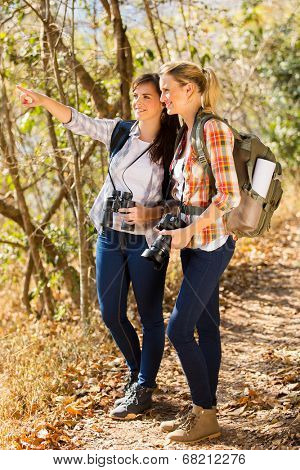 two female hikers in autumn mountain