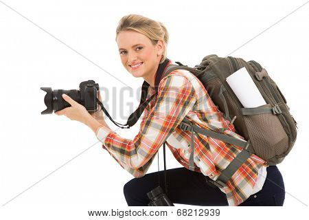attractive female photographer holding digital camera on white background