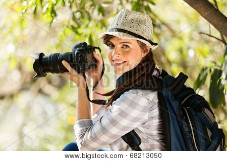 young woman taking photos in the nature