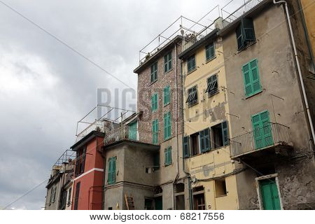 LIGURIA, ITALY - MAY 02, 2014: Riomaggiore, one of the Cinque Terre villages, UNESCO World Heritage Sites, remains a magnet for tourists to the famous Via dell'Amore remains closed, Riomaggiore, Italy