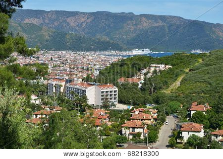 MARMARIS, TURKEY - APRIL 17, 2014: Cityscape of Marmaris with the cruise liner AIDAdiva anchored in port. AIDA ships cater to the German-speaking market, and has 94% average guests satisfaction rate