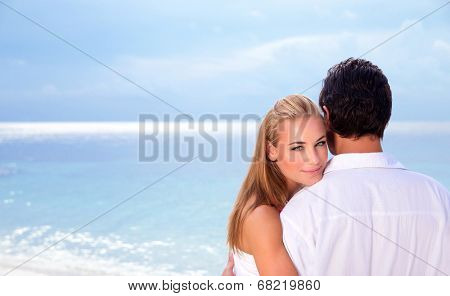 Wedding day on seashore, young family on the beach celebrating marriage, wife looking through husband shoulder, summer traveling, love concept