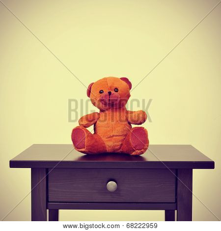 a teddy bear on a table on a beige background, with a retro effect