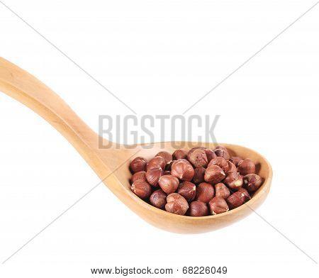 Spoon with hazelnuts.