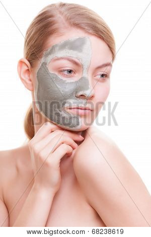 Woman With Clay Mask On Face.
