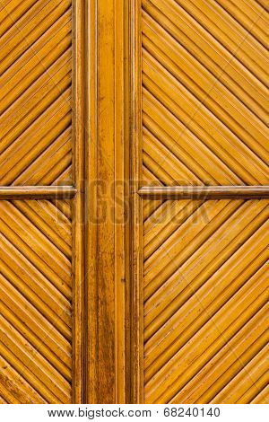 Wooden Rhomboid Pattern In A Yelowish  Door