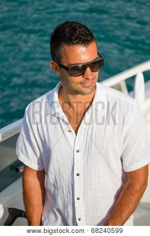 Handsome Young man on his yacht / powerboat