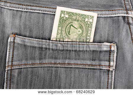 One Dollar Bill Sticking In The Back Pocket Of Denim  Black Jeans
