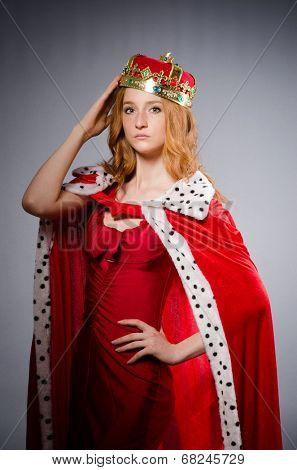 Queen in red dress in studio