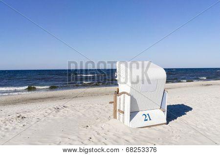 Empty sunbathing basket on the beach.