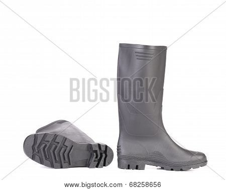 Gray rubber boots.