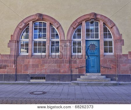 entrance with arched blue door and windows, Schkeuditz, Germany
