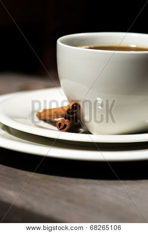 Two Heart Shaped Cinnamon Sticks On Saucer Next To Coffee Cup.
