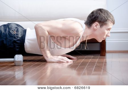 Man Doing Push-ups In Living Room