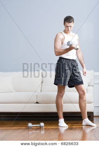 Man Using Arm Weights In Living Room