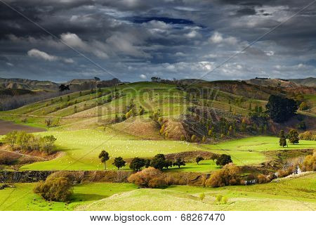 Landscape with farmland and cloudy sky, North Island, New Zealand