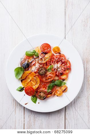 Ripe Fresh Colorful Tomatoes Salad With Olive Oil And Balsamic Vinegar On White Wooden Background