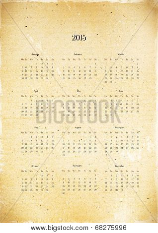 Old, decrepit calendar 2015 with charred edges, grunge.