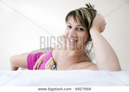 Beautiful Woman On Bed