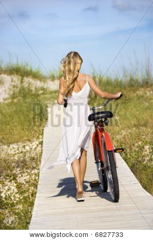 Girl Walking Bike On Boardwalk