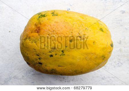 close up of whole ripe papaya fruit on an isolated background