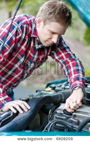 Man Working Under Car Hood